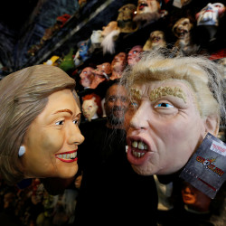 An employee holds up masks depicting Democratic presidential nominee Hillary Clinton and Republican presidential nominee Donald Trump at Hollywood Toys & Costumes in Los Angeles, California, Oct. 26, 2016.