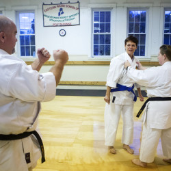 Glen Kennedy (left) goes over a self-defense move with Susannah Owen (center) and Hillary Kennedy during a demonstration at Eastern Maine School of Self-Defense in Veazie.