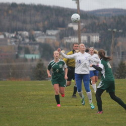 Madawaska's Sam Boucher (center) readies for the ball as Wisdom's Kerissa Rouleau (left) and Riley Theriault rush in during their Class D North quarterfinal soccer game on Wednesday in Madawaska.
