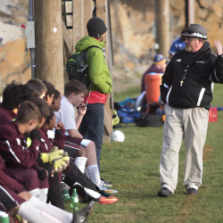 Washington Academy boys soccer coach Chris Gardner (right) talks to the players during the game against Sumner High School in East Machias on Tuesday.