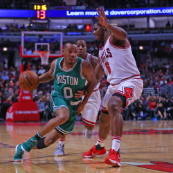 Boston Celtics guard Avery Bradley (0) drives against Chicago Bulls forward Cristiano Felicio (6) during the first half at the United Center in Chicago on Thursday night.