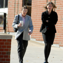 "Mary Kellett (right) is accompanied by Hancock County District Attorney Carletta ""Dee"" Bassano as she walks to the Penobscot Judicial Center for her prosecutorial misconduct hearing by the Maine Board of Overseers in this October 2012 file photo."