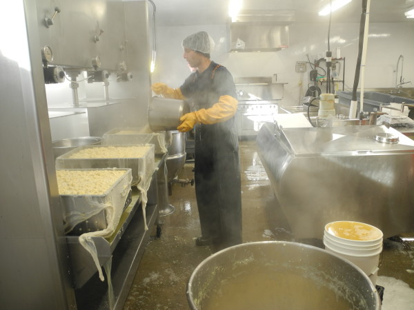 Jeff Wolovitz of Heiwa Tofu works on a batch of his product on Thursday morning at the company's new beanery, or manufacturing space, in Rockport.