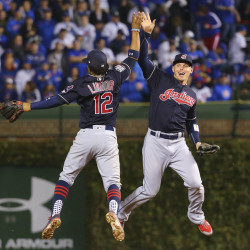 Cleveland Indians shortstop Francisco Lindor (left) celebrates with left fielder Brandon Guyer (right) after Game 3 of the World Series against the Chicago Cubs at Wrigley Field in Chicago on Friday night. The Indians defeated the Cubs 1-0.