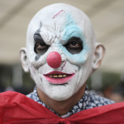 """A killer clown at the """"Zombie Walk"""" parade on Oct. 22, 2016 in Mexico City, Mexico."""