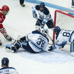 The University of Maine's Blaine Byron (right) stops the puck from falling into the back of their net while Matt Morris (center) and Cam Brown try to support during their game against Boston University at Alfond Arena in Orono on Jan. 22, 2016.