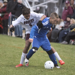 Washington Academy's D.J. Miller (left) and Sumner High School's Jordan Piper battle for the ball during their soccer game in East Machias on Oct. 25.