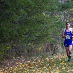 Waterville's Nicholas Dall leads the pack during the Class B cross country regional championships at Troy Howard Middle School in Belfast Saturday.