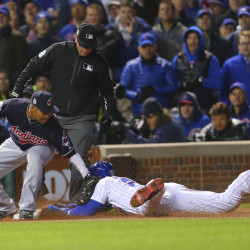 Chicago Cubs right fielder Jason Heyward (22) steals third base against Cleveland Indians third baseman Jose Ramirez (left) during the eighth inning in game four of the 2016 World Series at Wrigley Field.