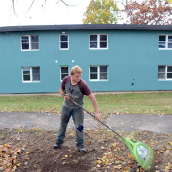Renovations continued at the former Pine Tree Inn of Bangor on Monday as Erick Parker of Bangor rakes leaves there.