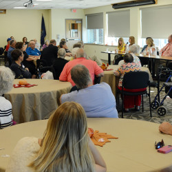 Occupational therapist Michaela St. Onge answers a question as part of a panel discussion at TAMC's Acute Rehab Reunion on Wednesday, September 21. The event brought together former patients, their families, and those responsible for their care to share their experiences.