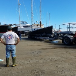 Tony Hooper (right) speaks with Celia Crie Knight of Knight Marine Service of Rockland as his lobster boat Liberty is hauled in for repairs on Monday afternoon in Rockland. Liberty has been intentionally sunk three times in the past six weeks off Port Clyde.