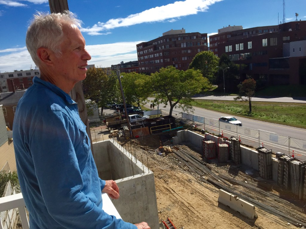 Developer Chip Newell surveys his new parking garage under construction. Residents of Luminato are paying