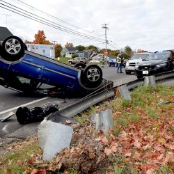 A Subaru rests on its roof after a single-vehicle accident at the intersection of Main Street and School Street in Damariscotta on Thursday.