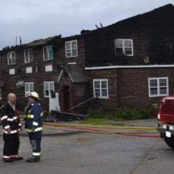 Thirteen people were displaced by a fire that destroyed a transitional housing center in Dresden early Sunday morning.