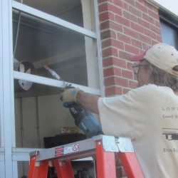 George Hamilton of Portland Glass removes framing for a window on Aug. 11 at Oceanside High School in Rockland. The 54-year-old school is undergoing significant repairs this fall and next year.