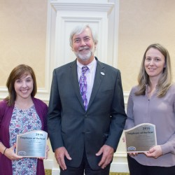 Lily Stadig, PCHC Clinical Employee of the Year (Left) featured with Angela Huff, PCHC  Non-Clinical Employee of the Year (Right), and  Ken Schmidt, MPA, President and CEO (Center).
