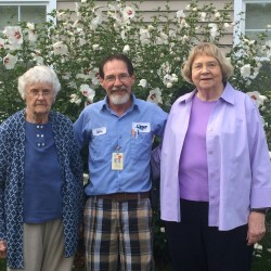 MHCA award winner Mike Flanagan (center) outside Quarry Hill's Anderson Inn with residents Eleanor McClelland (left) and Hannah Williamson.