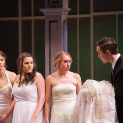 "Fenton Cummings (right) as Nikos urges sisters (left to right) Olympia (Mackenzie Peacock), Theyona (Nicole Felix) and Lydia (Katie Dube) tries to convince the women to marry him and his brothers in the University of Maine's production of ""Big Love."""