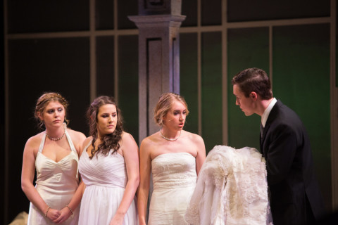 Fenton Cummings (right) as Nikos urges sisters (left to right) Olympia (Mackenzie Peacock), Theyona (Nicole Felix) and Lydia (Katie Dube) tries to convince the women to marry him and his brothers in the University of Maine's production of &quotBig Love.&quot