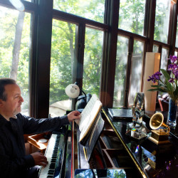 "Bangor Symphony Orchestra conductor Lucas Richman plays a selection from George Gershwin's ""Rhapsody in Blue"" at his home in Bangor on Wednesday."