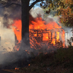 A structure burns on North Dyer Neck Road in Newcastle.