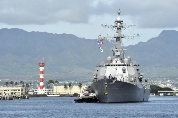 The guided-missile destroyer USS Sampson (DDG 102) arrives for a scheduled port visit in this U.S. Navy handout picture taken at Joint Base Pearl Harbor-Hickam, Hawaii, November 6, 2014.