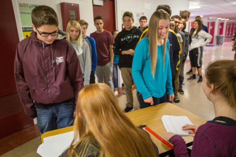 Bangor High School students check in to vote during classes on Tuesday in a statewide mock election.