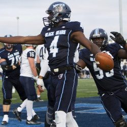 University of Maine's Jared Osumah celebrates after scoring a touchdown against New Hampshire during their football game at Alfond Stadium at the University of Maine in Orono Saturday. Ashley L. Conti | BDN