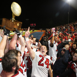 The Wells High School football team celebrates its 44-0 victory over Mount Desert Island High School in the Maine Class C State Football Championship game in Portland on Saturday night. Troy R. Bennett | BDN