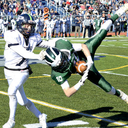 Bonny Eagle receiver Kordell Menard (10) hauls in a pass in front of Portland's Vincent Pasquali during the Class A state final at Fitzpatrick Stadium in Portland on Saturday.   Justin Pelletier/Sun Journal