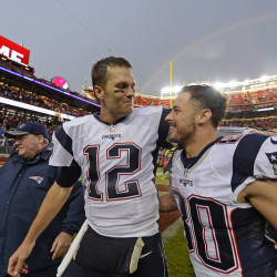 New England Patriots quarterback Tom Brady (12) celebrates with teammate Danny Amendola (80) as they walk off the field after defeating the San Francisco 49ers on Sunday at Levi's Stadium in Santa Clara, Calif. New England won 30-17.