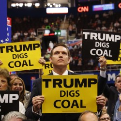 Delegates from West Virginia hold signs supporting coal on the second day of the Republican National Convention in Cleveland, Ohio, in July.
