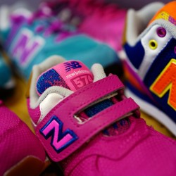 Children's sneakers made by New Balance are displayed at a clothing shop in Hanau, near Frankfurt, Germany, recently.
