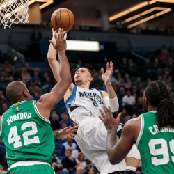 Minnesota Timberwolves guard Zach LaVine (8) shoots over Boston Celtics center Al Horford (42) in the second quarter on Monday night at the Target Center in Minneapolis.