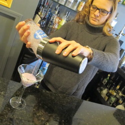 Owner Melissa Smith makes a drink at Happy Endings, her martini bar in downtown Bangor.