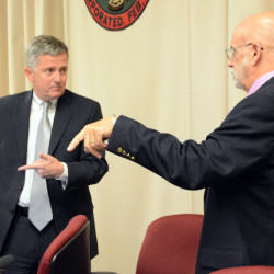 Bangor City Solicitor Norman Heitmann (right) and City Council Chairman Sean Faircloth confer before a special council meeting on Tuesday in Bangor. Councilors unanimously voted for a six-month moratorium on city recreational marijuana facilities.