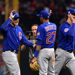 Chicago Cubs players from left Anthony Rizzo , Addison Russell and Kris Bryant celebrate after defeating the Cleveland Indians in Game 6 of the World Series at Progressive Field in Cleveland on Tuesday night,.