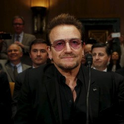 """U2 lead singer Bono attends a Senate Appropriations State, Foreign Operations and Related Programs Subcommittee hearing on """"causes and consequences of violent extremism and the role of foreign assistance"""" on Capitol Hill in Washington, April 12, 2016."""