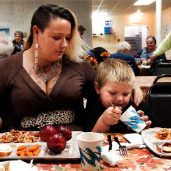 Single mother Adena Wilcox and her son, Michael, eat dinner at St. Anthony's Soup Kitchen in Skowhegan.