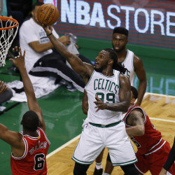 Boston Celtics forward Jae Crowder (99) drives to the basket during the first quarter against the Chicago Bulls at TD Garden.
