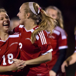 Camden Hills' Kristina Kelly (left) celebrates with teammate Taylor Johnson after defeating Bangor during their girls soccer regional championship game at Bangor Wednesday.