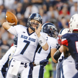 University of Maine quarterback Dan Collins looks downfield to throw a pass against Connecticut in East Hartford, Connecticut, on Sept. 1. Collins will lead Maine against conference foe Villanova at noon Saturday in Orono.