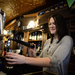 Brittany Foye, who is a server at Paddy Murphy's, says she is not in favor of Question 4, which is about raising the minimum wage, on Friday in Bangor. Foye, who has worked in the restaurant business for nine years, believes it will affect small businesses and change the way servers serve.