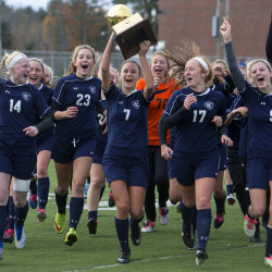 Yarmouth celebrates after defeating Waterville during their Class B girls state championship soccer game at Hampden Academy Saturday.