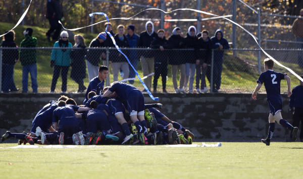 Yarmouth celebrates after defeating Winslow during their Class B boys state championship soccer game at Hampden Academy Saturday.