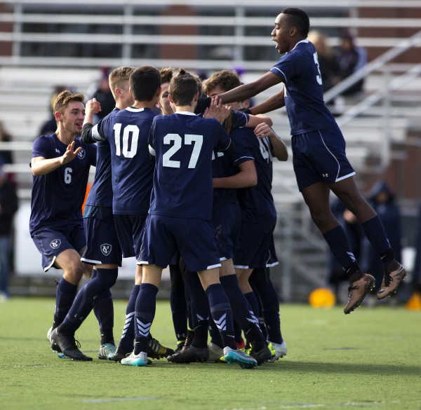 Yarmouth celebrates after scoring a goal against Winslow during their Class B boys state championship soccer game at Hampden Academy Saturday.