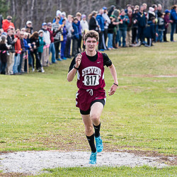 John Hassett of George Stevens Academy in Blue Hill approaches the finish line on his way to the individual victory during the Class C cross country state championships in Belfast on Saturday afternoon.