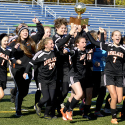 The Ashland girls' soccer team hoists the gold ball after winning the Class D state title over Richmond 2-1 in double overtime at Fitzpatrick Stadium in Portland on Saturday.