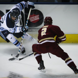 University of Maine's Brendan Robbins (left) fights for the puck with Boston College's Scott Savage on Friday night at the Cross Insurance Arena in Portland.